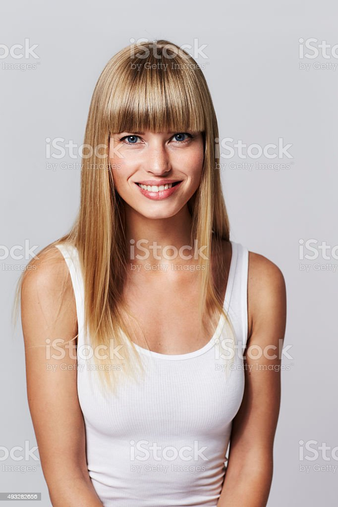 Portrait of young blond woman in white vest stock photo