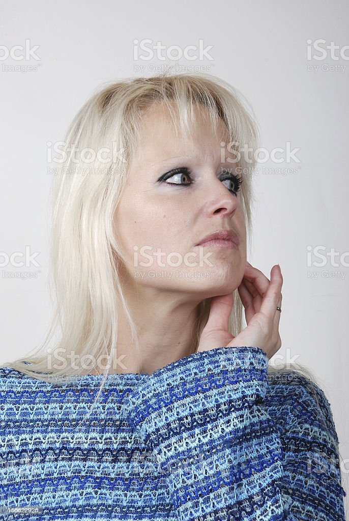 Portrait of young blond woman thinking and looking somewhere up royalty-free stock photo