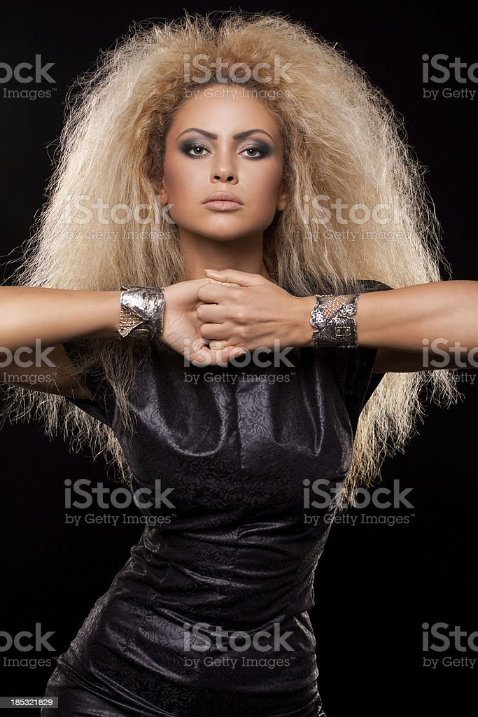 Portrait of young blonde fashion model posing stock photo