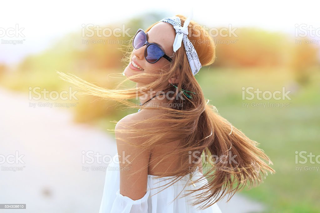 Portrait of young boho woman with flowing hair stock photo