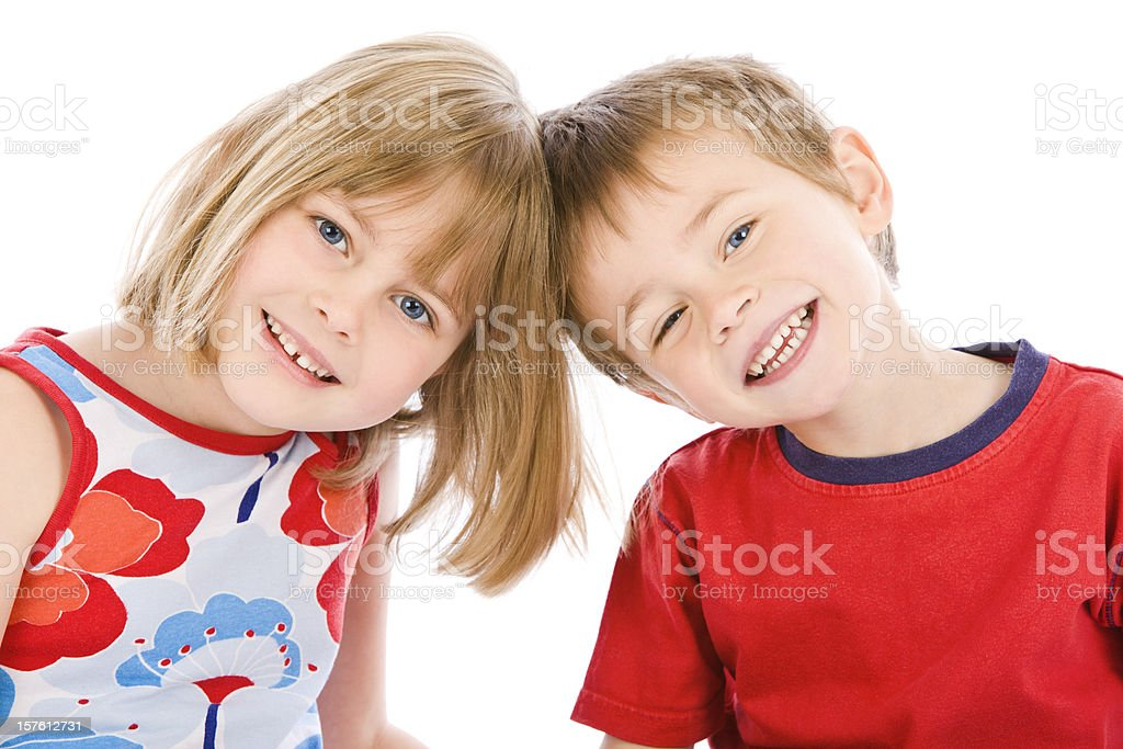 Portrait of young boy and girl on white background royalty-free stock photo