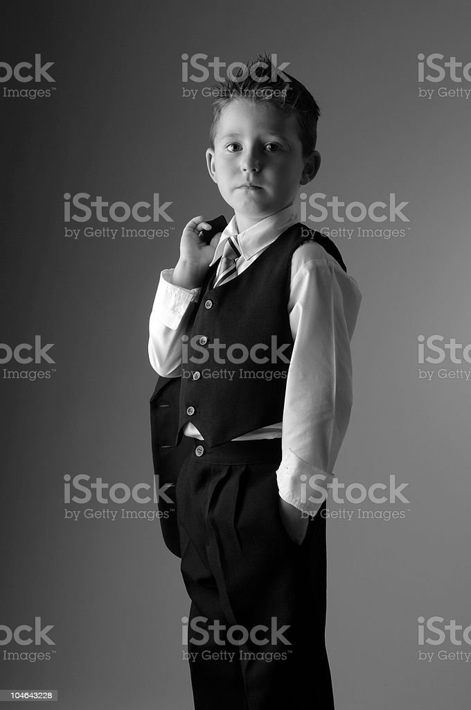 Portrait of young boy in a suit stock photo