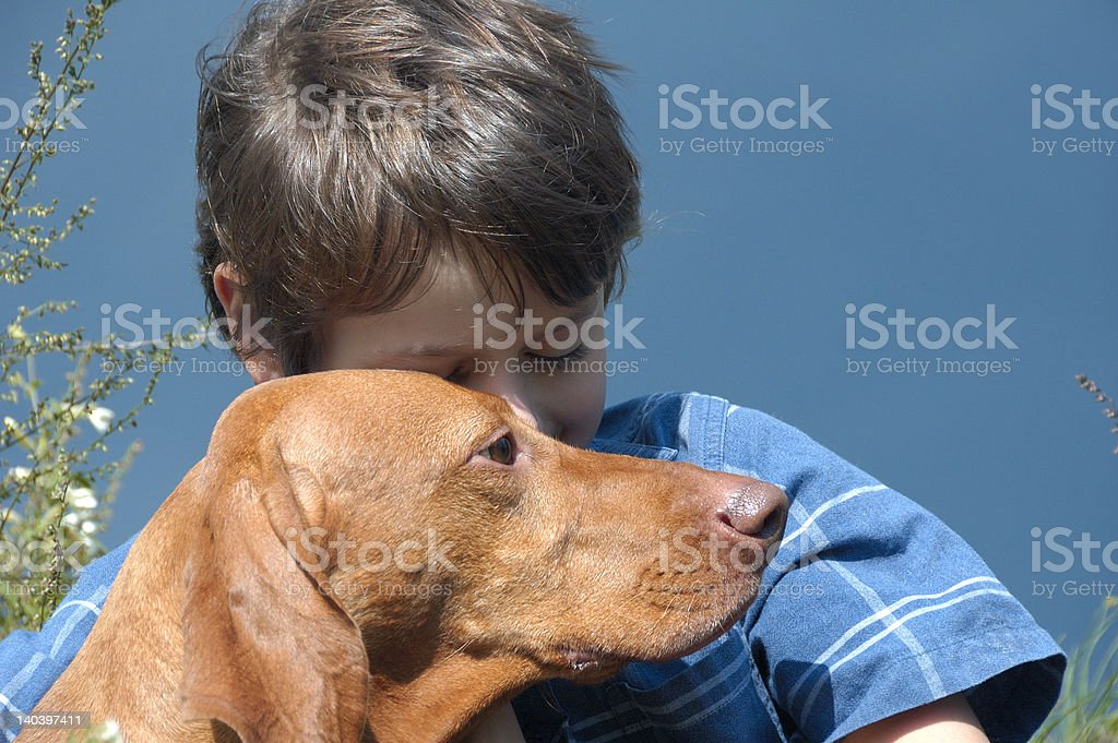 Portrait Of Young Boy With His Dog royalty-free stock photo