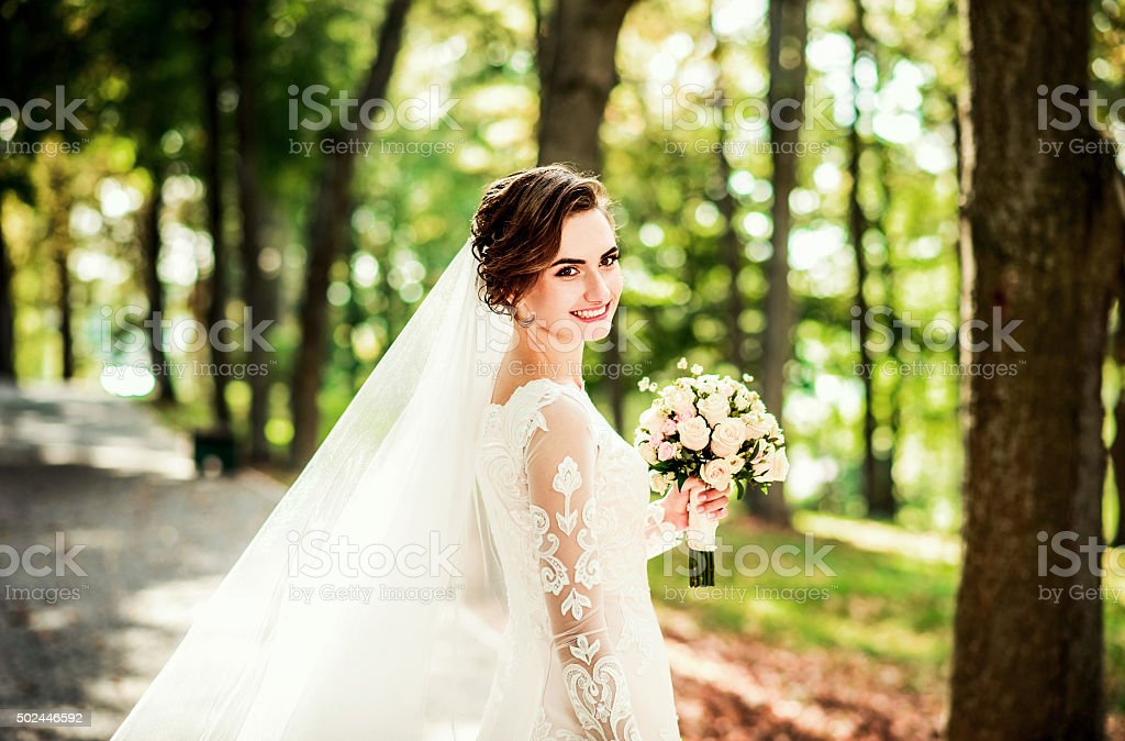 Portrait of young bride with bouquet of flowers stock photo