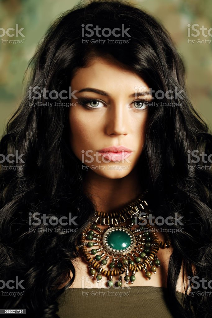 Portrait of young brunette girl with long curly hair stock photo