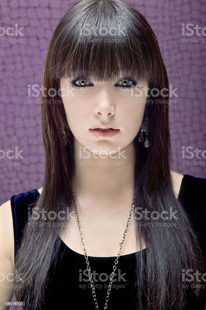 Portrait of Young Brunette Woman on Purple Background royalty-free stock photo