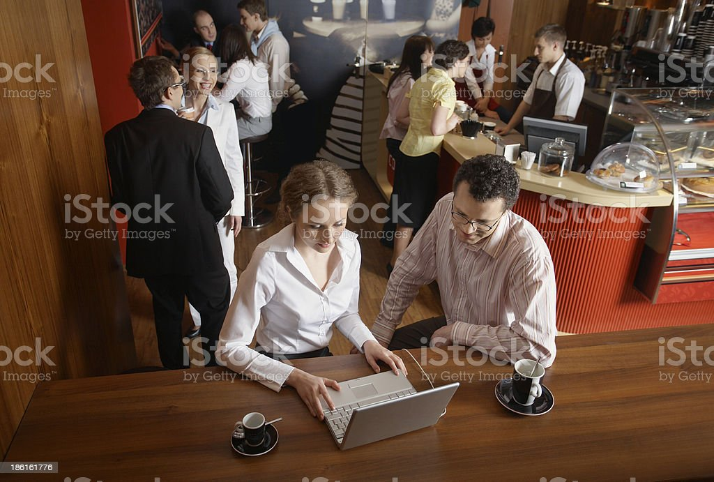 Portrait of young business people working on laptop at cafe royalty-free stock photo