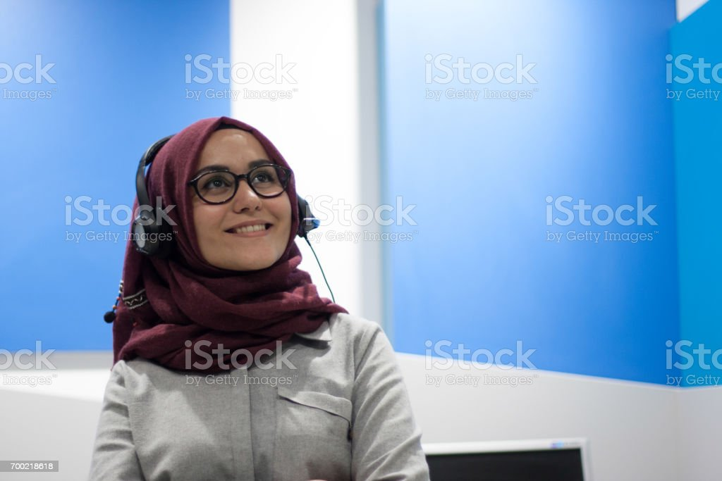 Portrait of young business woman in office stock photo