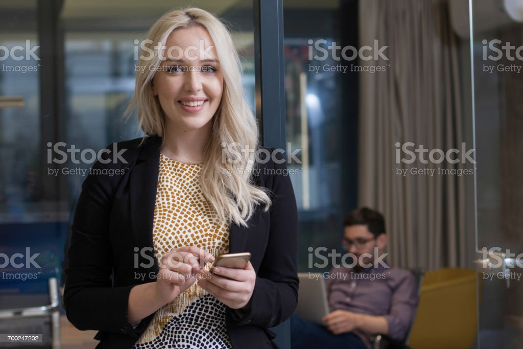 Portrait of young business woman working relaxed stock photo