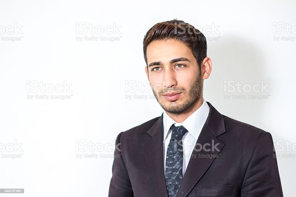 Portrait of young businessman against white background stock photo