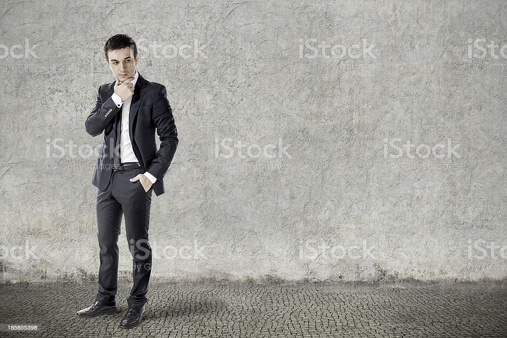 portrait of young businessman on grunge background royalty-free stock photo