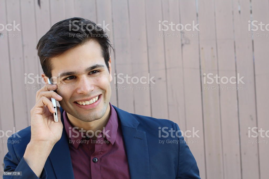 Portrait of young businessman talking on the phone stock photo