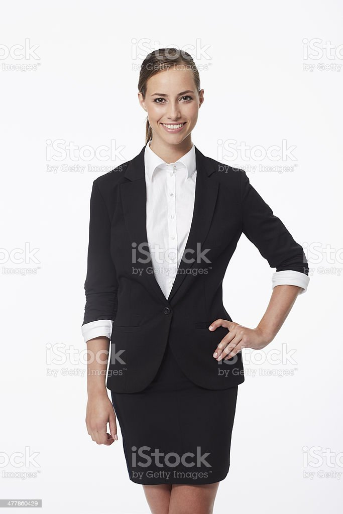 Portrait of young businesswoman against white background stock photo