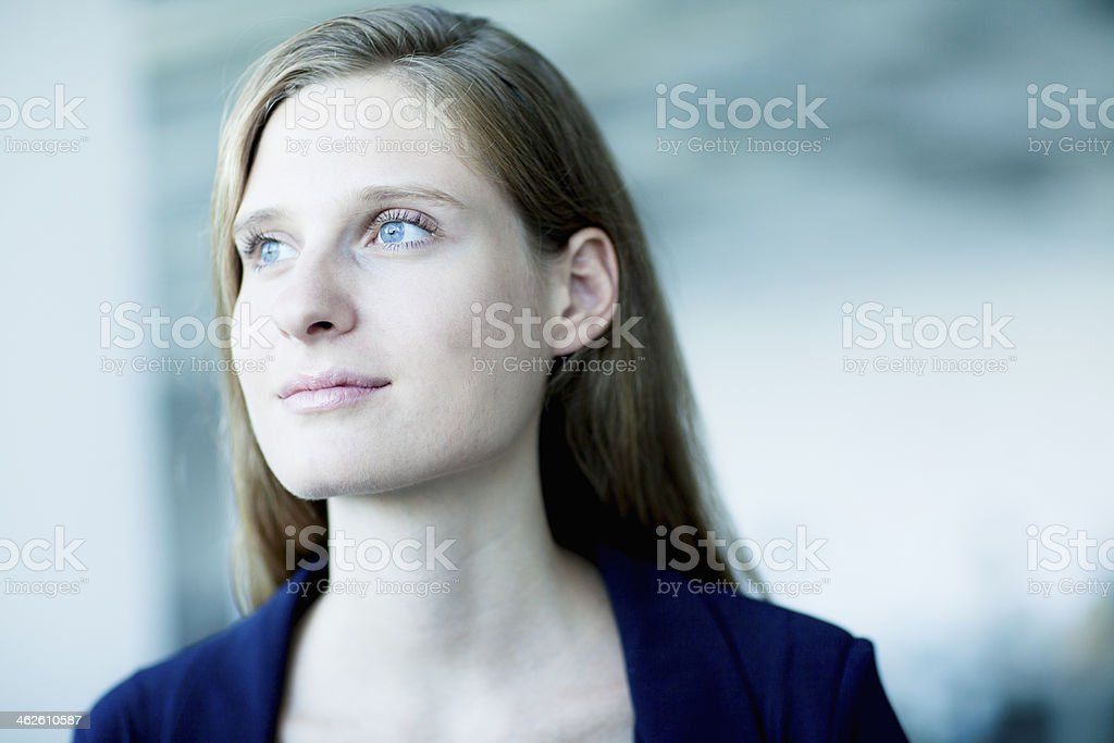 Portrait of young businesswoman looking away in contemplation stock photo