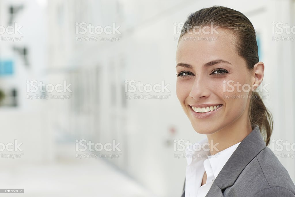 Portrait of young businesswoman smiling royalty-free stock photo