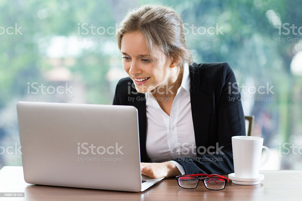 Portrait of Young Businesswoman Working on Laptop Computer and S stock photo