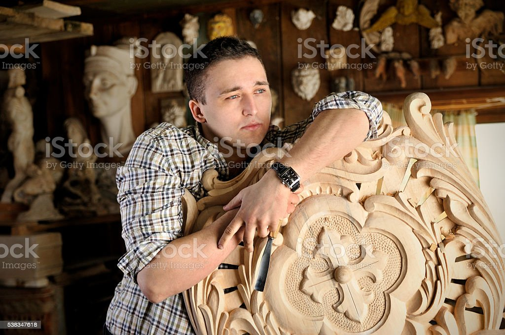 Portrait of young carver in his studio stock photo