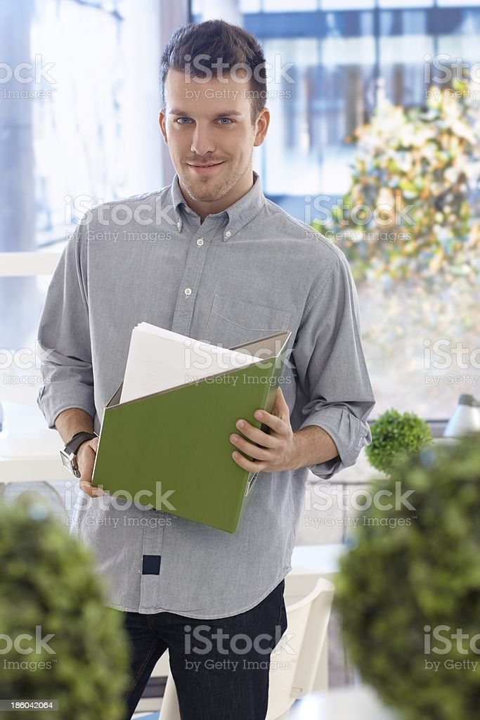 Portrait of young casual office worker smiling royalty-free stock photo