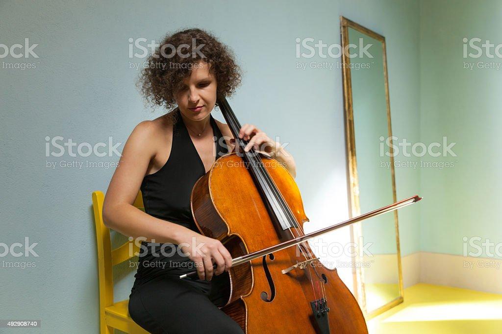 Portrait of young cellist stock photo
