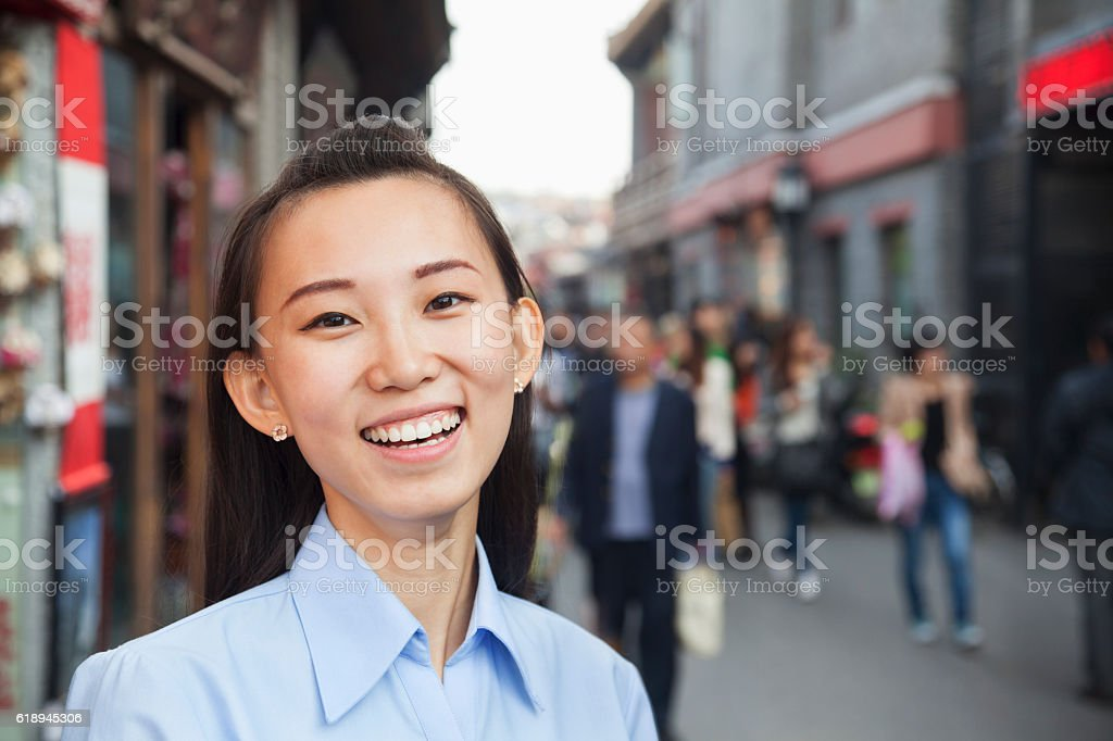 Portrait of young Chinese woman in pedestrian walking street stock photo
