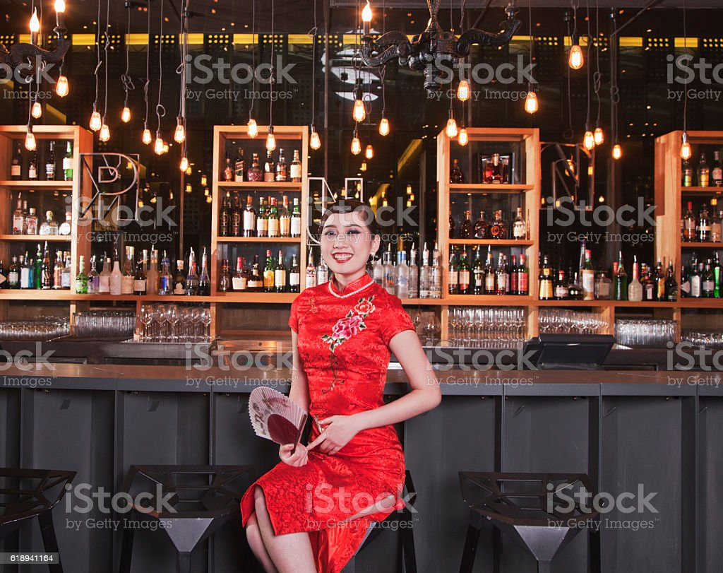 Portrait of young Chinese woman in traditional qipao dress stock photo