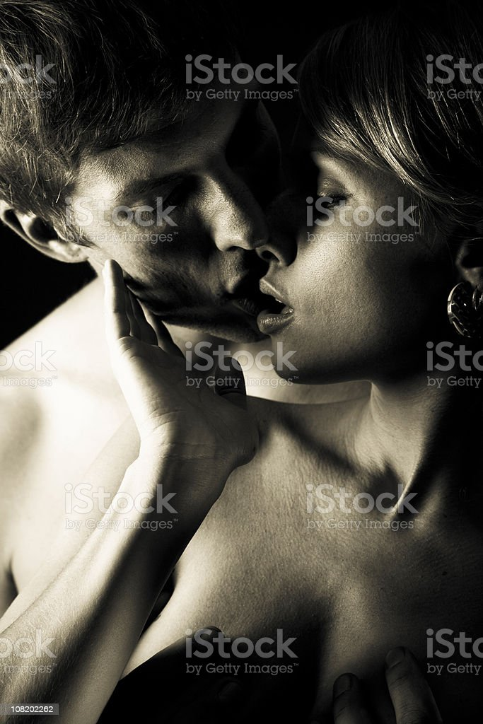 Portrait of Young Couple About to Kiss, Black and White stock photo