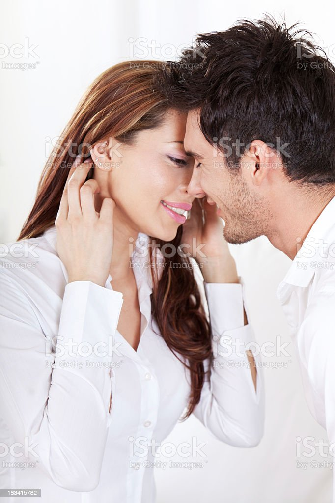 Portrait of young couple about to kiss royalty-free stock photo