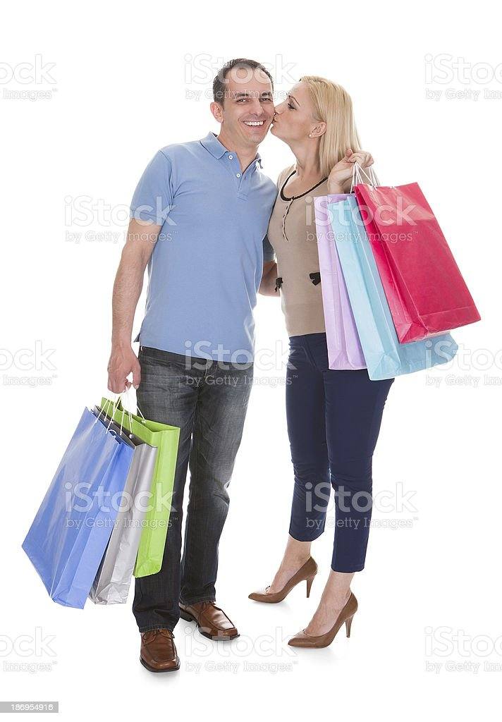 Portrait Of Young Couple Holding Shopping Bag royalty-free stock photo