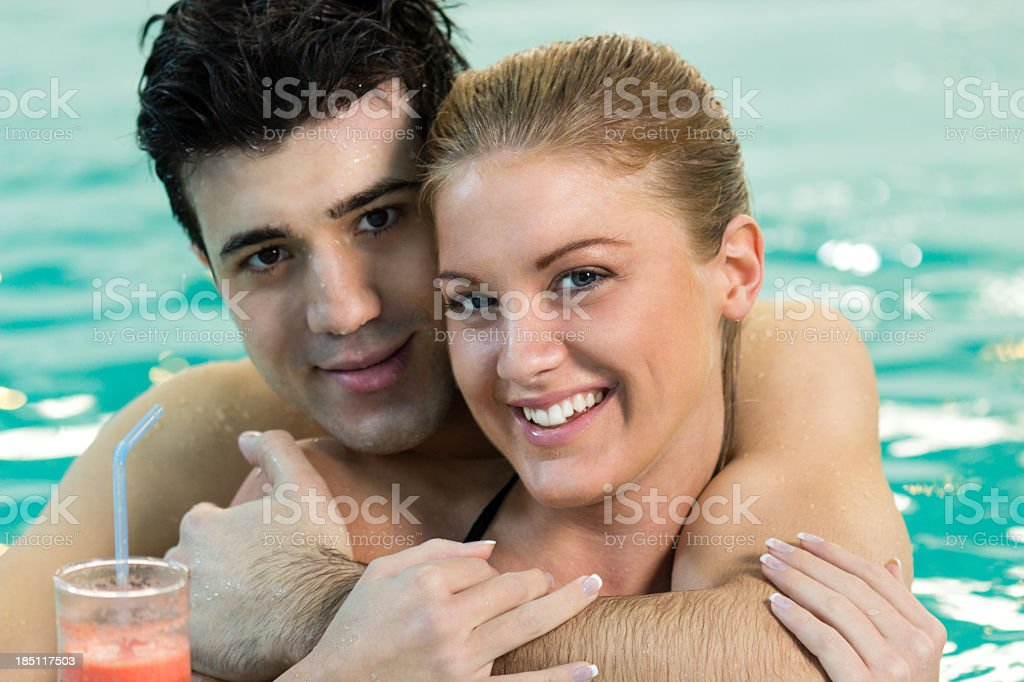 Portrait of young couple in the pool stock photo