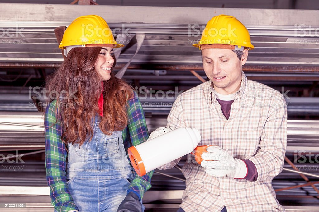portrait of young couple of workers on coffee break stock photo