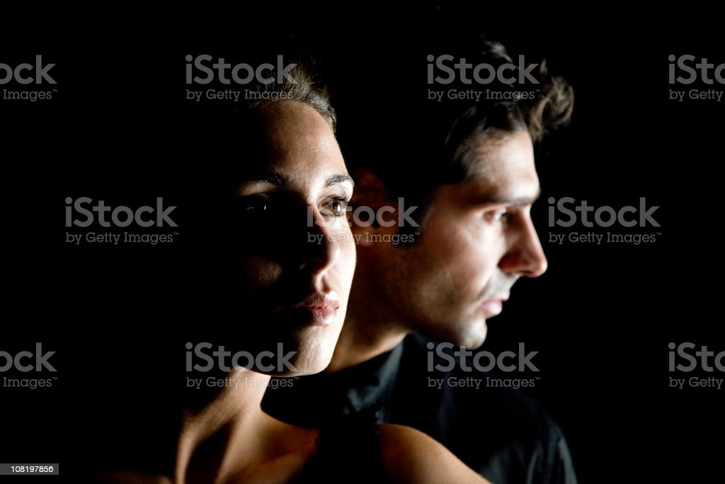 Portrait of Young Couple on Black Background, Low Key royalty-free stock photo
