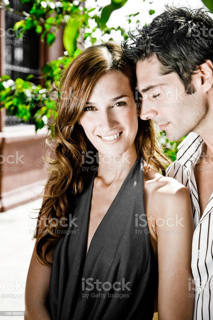 Portrait of Young Couple Posing Outside royalty-free stock photo
