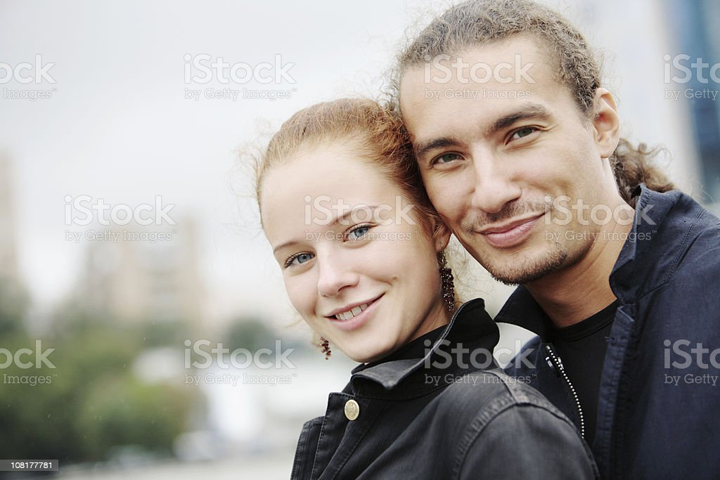 Portrait of Young Couple Smiling Outside royalty-free stock photo