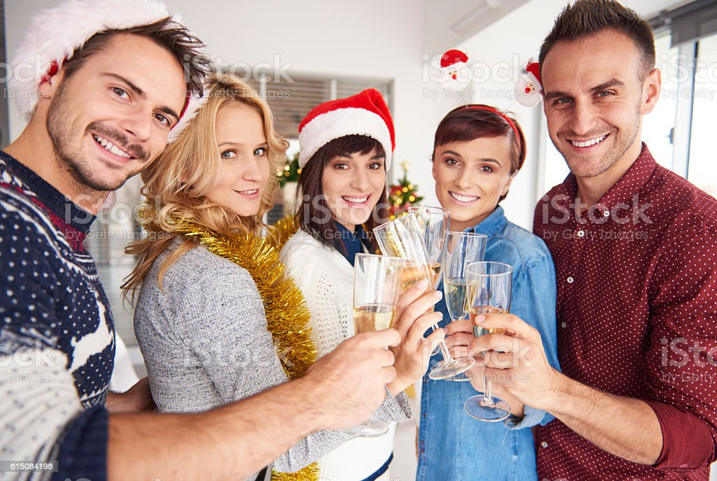 Portrait of young coworkers having a toast stock photo