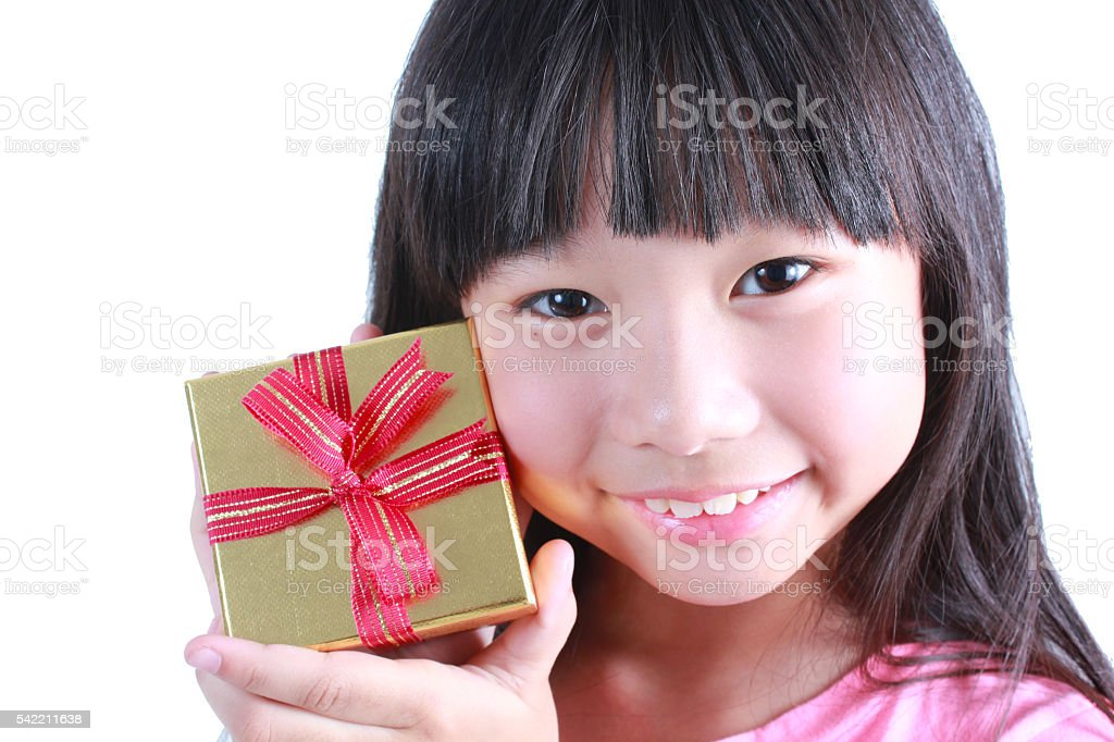 Portrait of young cute girl holding a present Lizenzfreies stock-foto