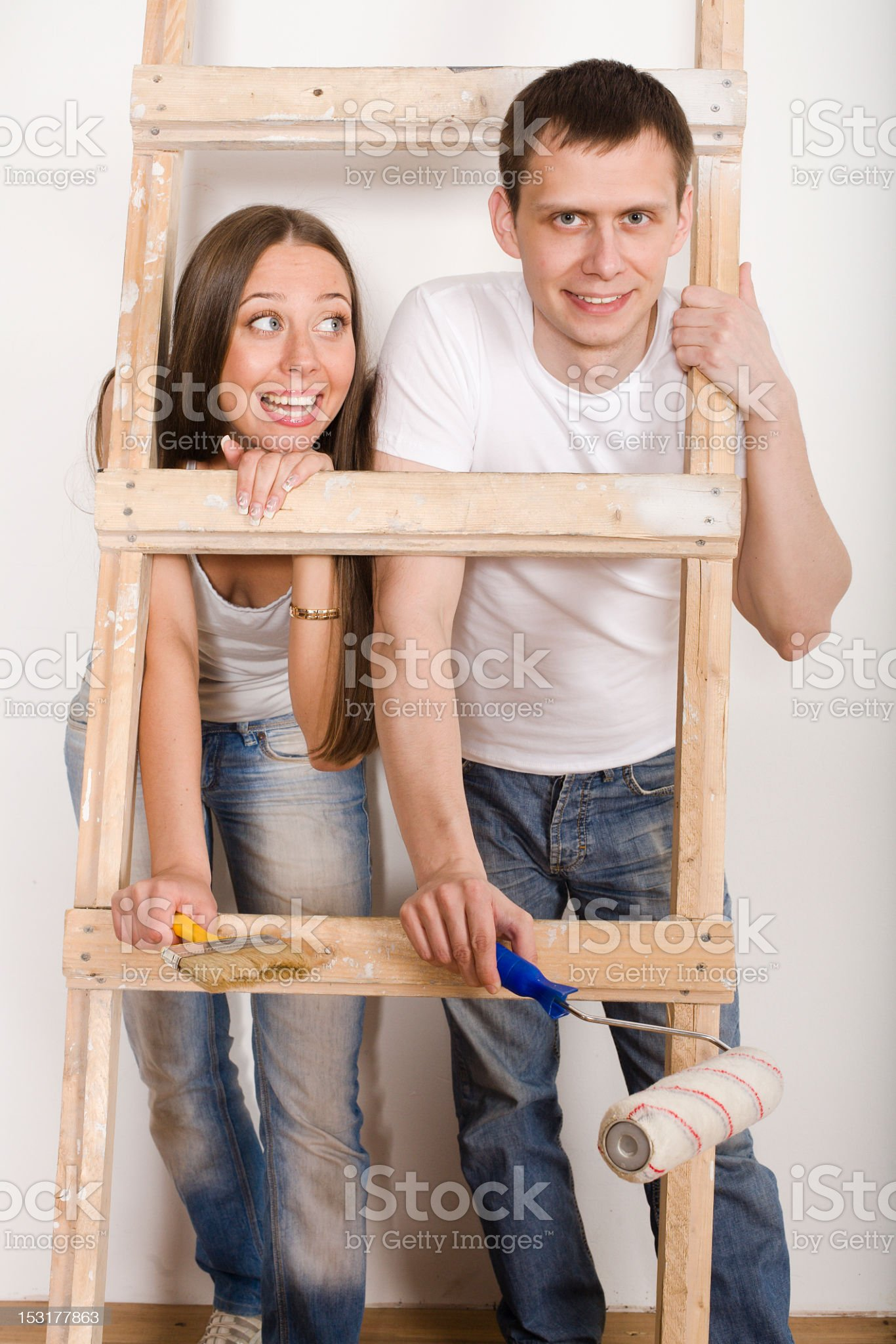 portrait of young family repairing new flat royalty-free stock photo