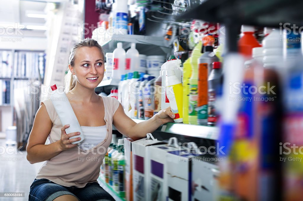Portrait of young female customer taking bottle stock photo