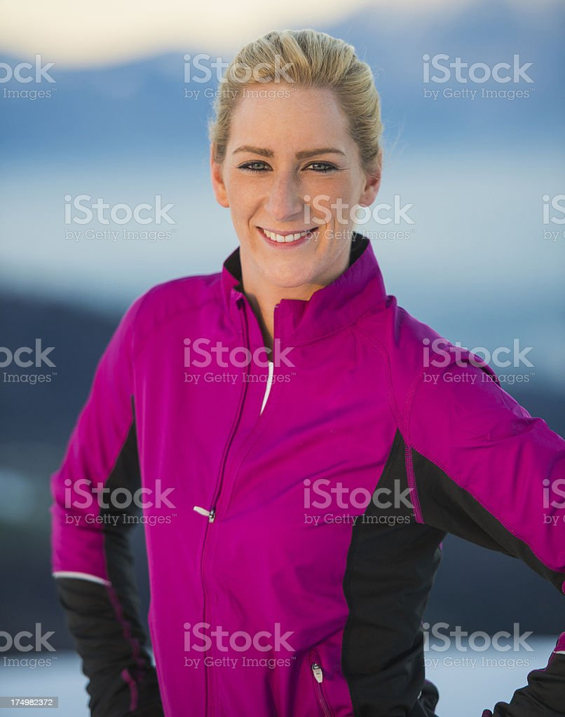 Portrait of young female runner at sunset stock photo