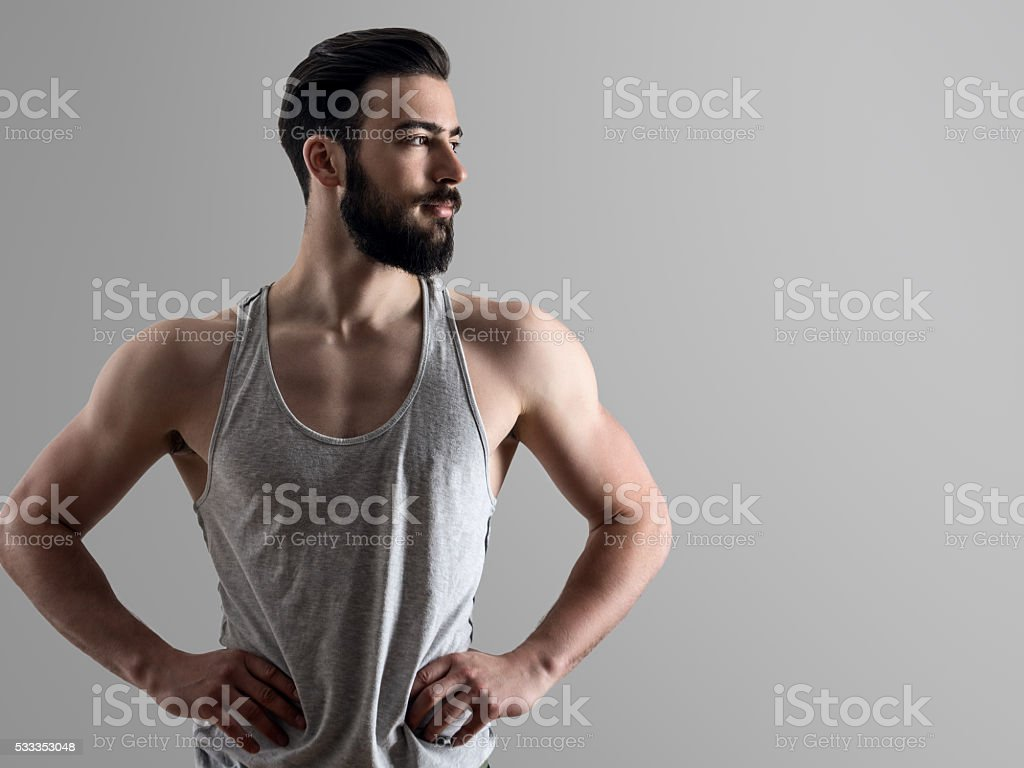 Portrait of young fit man with hands on hips stock photo