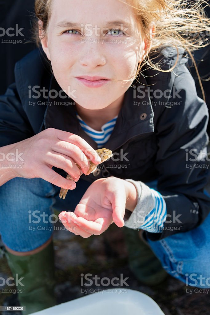 Portrait of Young Girl Holding a Goby Fish stock photo