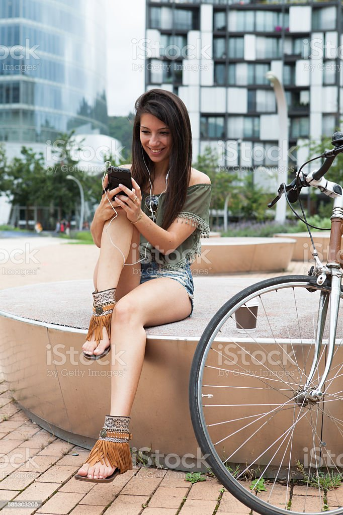 Portrait of young girl in the city stock photo