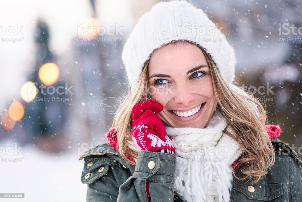 Portrait of young girl on the phone stock photo
