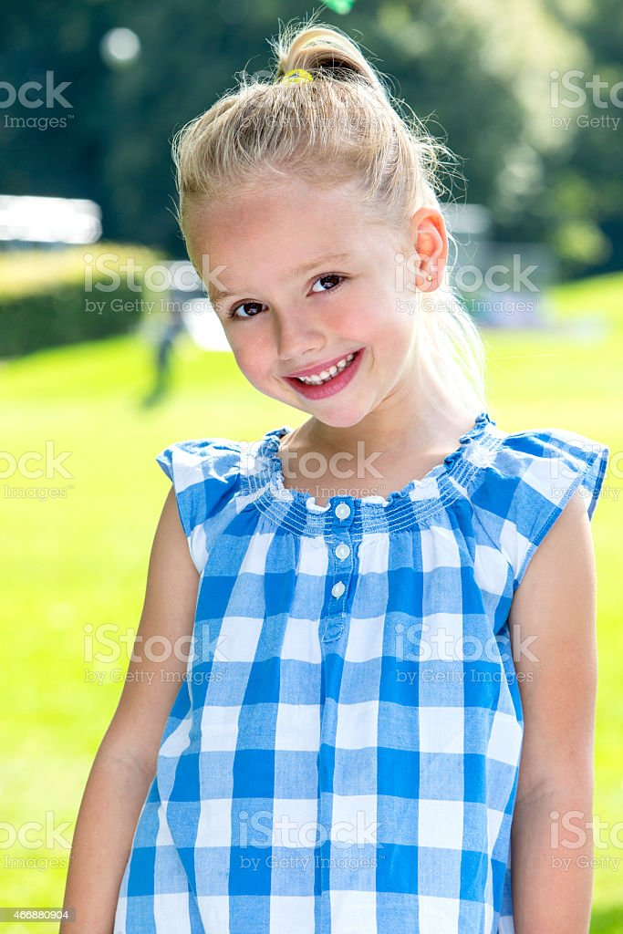 Portrait of Young Girl Outdoors stock photo