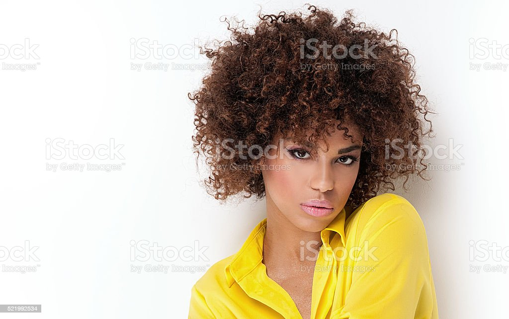 Portrait of young girl with afro. stock photo