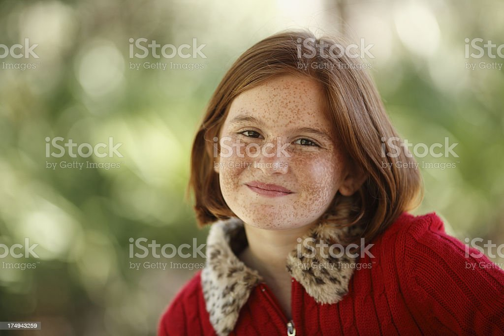 Portrait of young girl with freckles and red hair royalty-free stock photo
