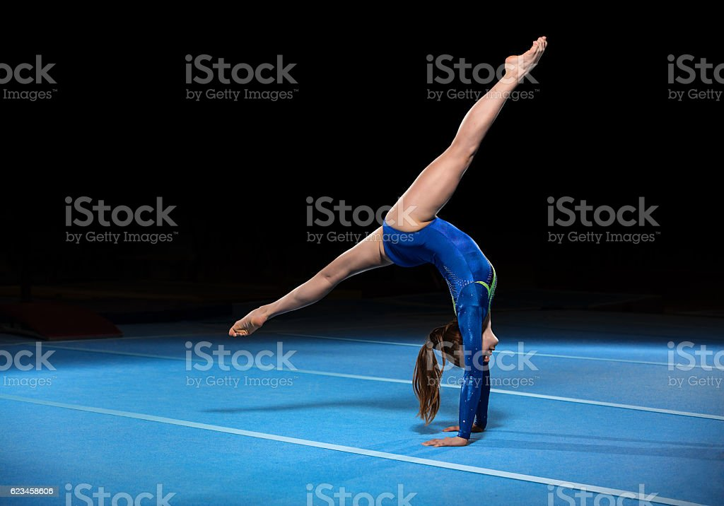 portrait of young gymnasts competing in the stadium stock photo
