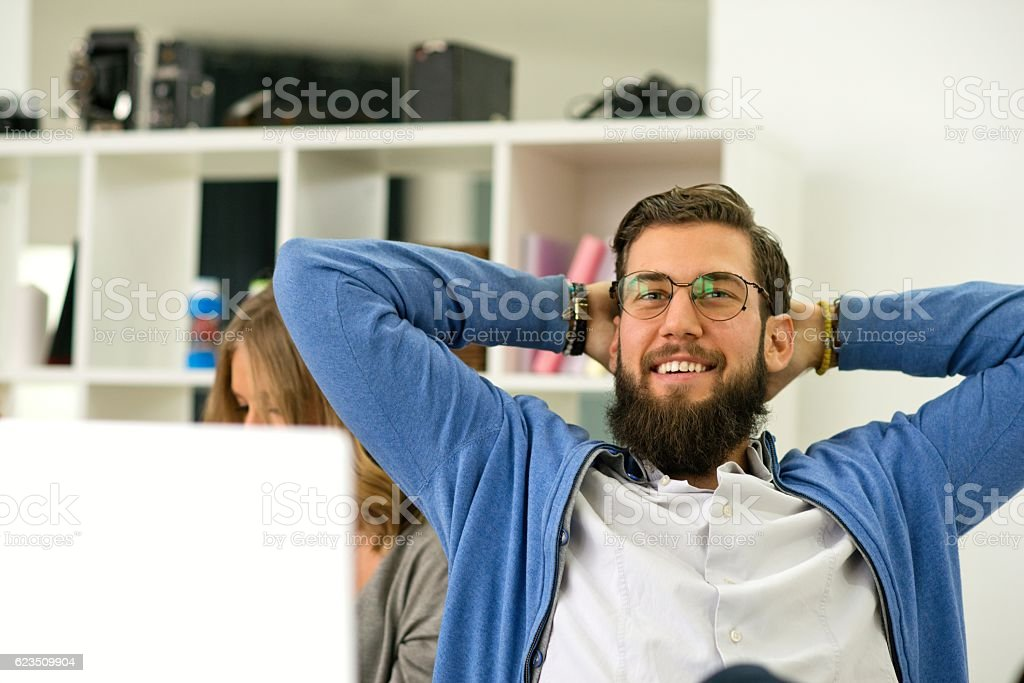 Portrait of young handsome businessman relaxing. stock photo