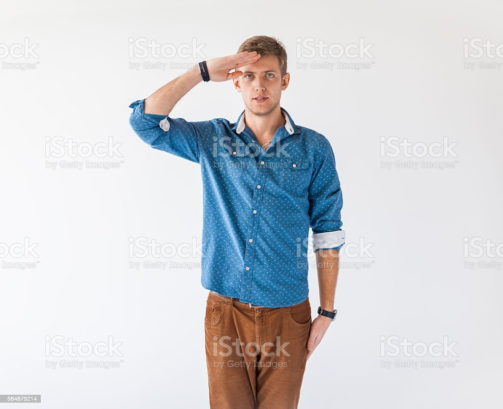 Portrait of young handsome man saluting stock photo