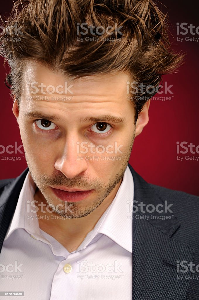 Portrait of young handsome man with matted hair stock photo