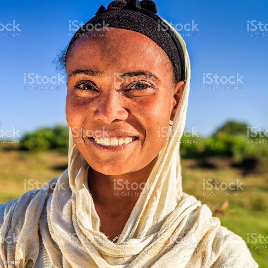 Portrait of young, happy  African woman, Ethiopia, Africa stock photo